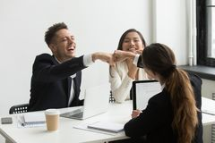 Excited colleagues giving fists bump celebrating success. Excited happy colleagues giving fists bump celebrating successful project, professional goal royalty free stock image