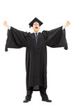Excited college graduate throwing his hands in the air and gestu. Full length portrait of excited college graduate throwing his hands in the air and gesturing Stock Photography