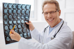 Excited committed neurosurgeon doing his job Stock Photos