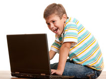 Excited computer game player. A closeup portrait of a handsome boy yelling while playing a computer game; isolated on the white background Royalty Free Stock Image
