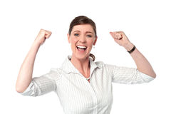 Excited corporate lady with clenched fists Stock Photography