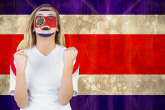 Excited costa rica fan in face paint cheering Stock Images