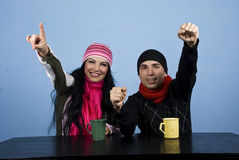 Excited Couple At Table In Winter Season Stock Photos