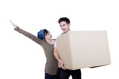 Excited couple bring box - isolated. Excited Asian couple bring box on white background Stock Photos