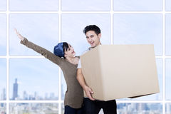 Excited couple bring box at new apartment Royalty Free Stock Photos