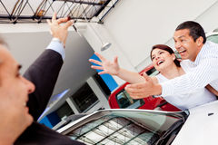 Excited couple buying a car Stock Photos