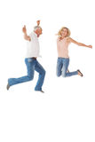 Excited couple cheering and jumping Stock Images