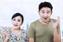 Excited couple expression in apartment Royalty Free Stock Photo