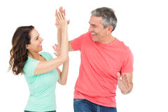 Excited couple giving a high-five Stock Images