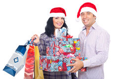 Excited couple holding Christmas presents Royalty Free Stock Image