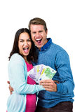 Excited couple holding money Royalty Free Stock Photos