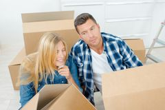 Excited couple moving home stock photo