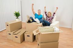 Excited couple in new home Stock Images
