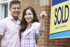Excited Couple Outside New Home Holding Keys Stock Images