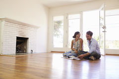 Excited Couple Planning Decoration Of New Home Stock Photography