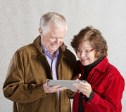 Excited Couple with Tablet Royalty Free Stock Photo