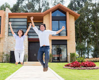 Excited couple about their house Royalty Free Stock Image