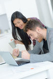 Excited couple using laptop Royalty Free Stock Image