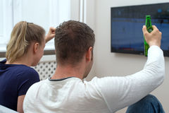 Excited couple watching hockey. Stock Images