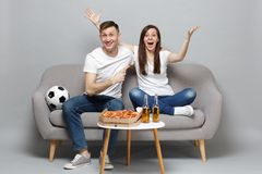 Excited couple woman man football fans cheer up support favorite team, pointing index finger, spreading hands isolated. Excited couple women men football fans royalty free stock photography
