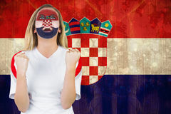 Excited croatia fan in face paint cheering Stock Photo