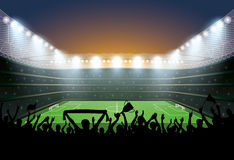 Excited crowd of people at a soccer stadium. Football stadium. Royalty Free Stock Images