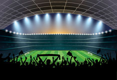 Excited crowd of people at a soccer stadium. Football stadium. Royalty Free Stock Photography