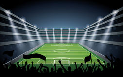 Excited crowd of people at a soccer stadium. Royalty Free Stock Photography