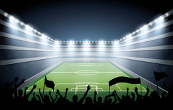 Excited crowd of people at a soccer stadium. Royalty Free Stock Image