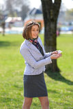Excited cute woman counts money in the park Stock Image