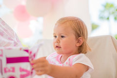 Excited Cutie Unwrapping Her Birthday Present Stock Images