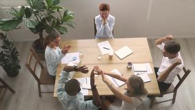 Excited diverse business team people applaud give high-five celebrate success