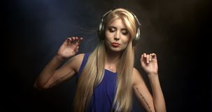 Excited DJ girl on decks on the party stock video footage
