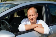 Excited driver holding the keys of his new car Stock Images