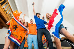 Excited Dutch sports fans Royalty Free Stock Images