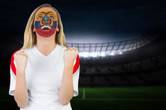 Excited ecuador fan in face paint cheering Royalty Free Stock Images
