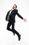Excited elated happy young business man jumping and shouting stock photography