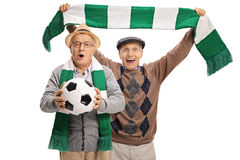 Excited elderly football fans cheering Stock Photos