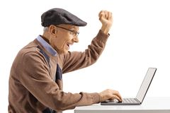 Excited elderly man with a laptop computer gesturing happiness. Isolated on white background royalty free stock photo