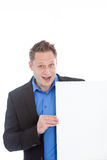 Excited enthusiastic man holding a blank sign Royalty Free Stock Images