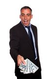 Excited executive holding and showing cash money Stock Image