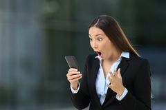 Excited executive reading amazing news on line Royalty Free Stock Photography