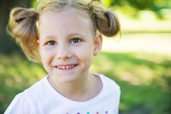 Excited face of pretty girl in summer park Royalty Free Stock Photography