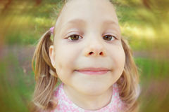 Excited face of pretty girl in summer park Stock Images