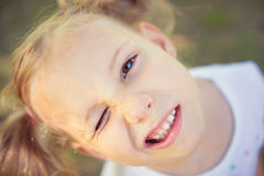 Excited face of pretty girl in summer park Stock Image