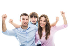Excited family with arms raised Stock Image