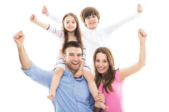 Excited family with arms raised Royalty Free Stock Images