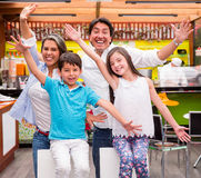 Excited family with arms up Stock Images