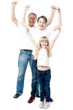 Excited family with arms up. Happy family celebrating with arms up Stock Image