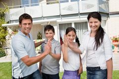 Excited family celebrating buying new house. Portrait of happy young family giving high five to eachother Stock Photo